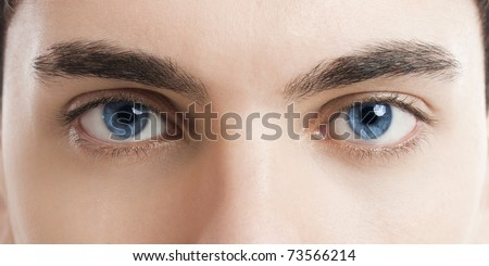 Close-up picture of blue eyes from a young man - stock photo