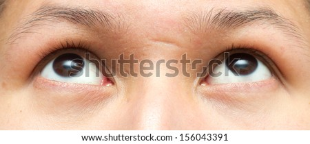 Close-up picture of brown eyes from a young man - stock photo