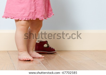 Close up picture of cute baby legs in a room - stock photo