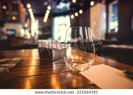Close up picture of empty glasses in restaurant - stock photo
