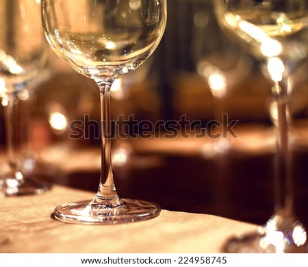 Close up picture of empty glasses in restaurant. Selective focus - stock photo