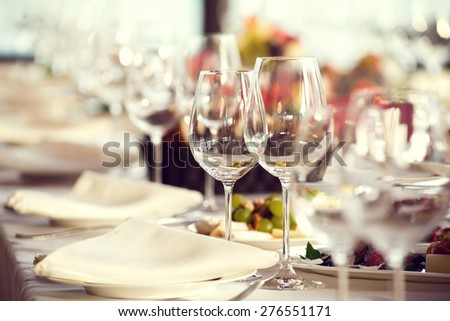 Close up picture of empty glasses in restaurant. Selective focus.