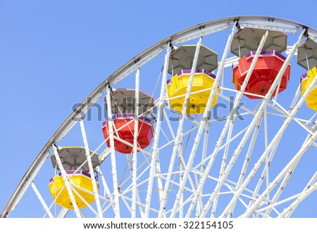 Close up picture of ferris wheel against blue sky in amusement park. - stock photo