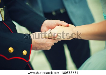 Close up picture of holding hands and engagement ring - stock photo