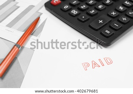 close-up picture of invoices with red paid stamp, paperwork at office - stock photo