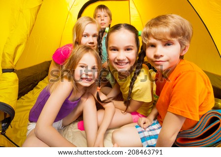 Close-up picture of kids in tent