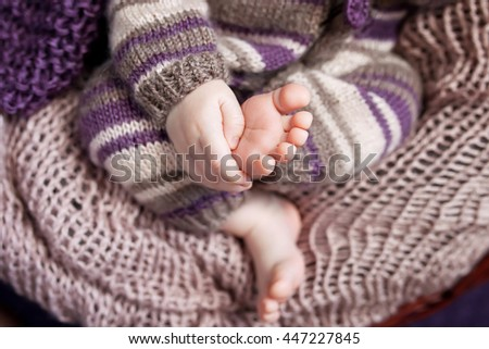Close up picture of new born baby feet and hand - stock photo