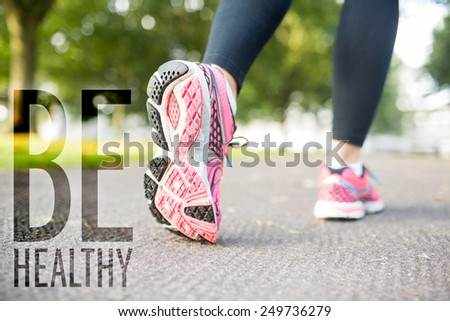 Close up picture of pink sneakers against be healthy - stock photo