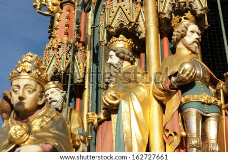 Close-up picture of the famous wooden figures at the fountain Schoner Brunnen in Nuremberg - stock photo