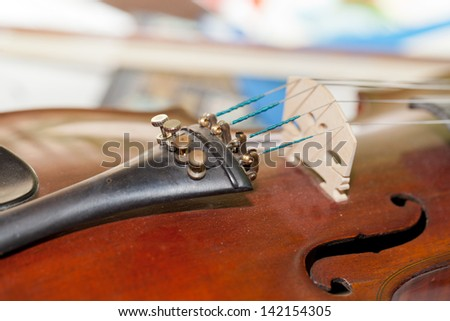 Close-up picture of the old  violin with score - stock photo