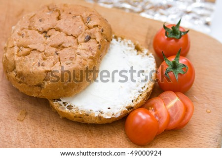 close up piece of bread with cottage cheese and tomatoes - stock photo