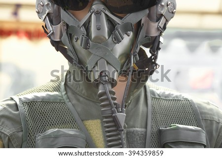 Close-up pilot wearing mask and helmet.