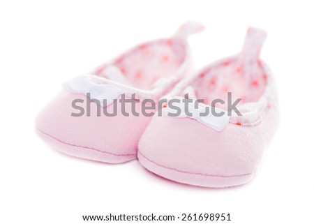 Close up pink baby shoes isolated on white background - stock photo