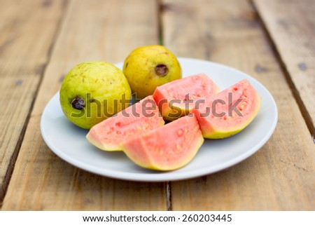 Close up pink guava on white dish - stock photo