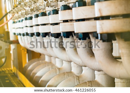 Close up pipe line manifold in Offshore Industry oil and gas production petroleum pipeline.