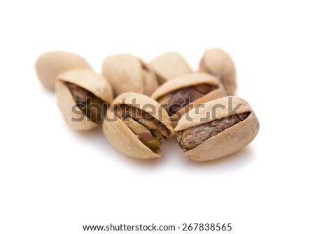 close up pistachio nuts on white with clipping path - stock photo