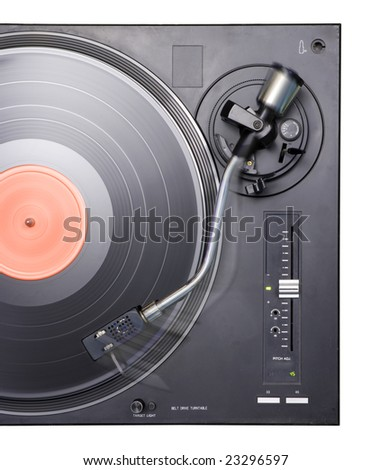 close-up plan view of record deck; movement of pick-up arm across record is visible - stock photo