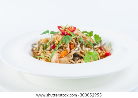 Close up  Plate of Seafood Pasta with vegetables, decorated with herbs on the white plate isolated