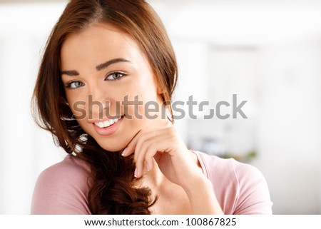 Close-up portrai of an attractive young woman smiling - stock photo