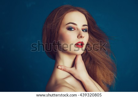 Close-up portrait beautiful woman on a blue background. Spa, skincare and cosmetology female shoot. - stock photo
