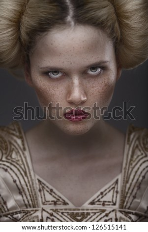 close-up portrait fashion beauty model with freckles on dark grey background - stock photo