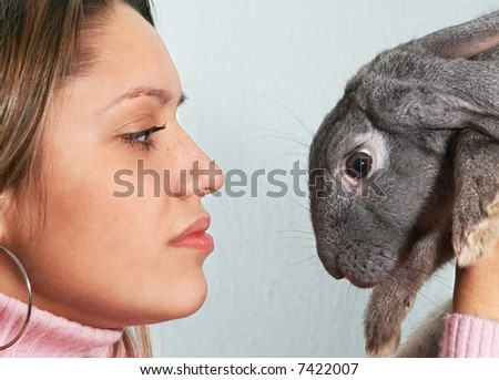 close-up portrait girl holding rabbit on hand