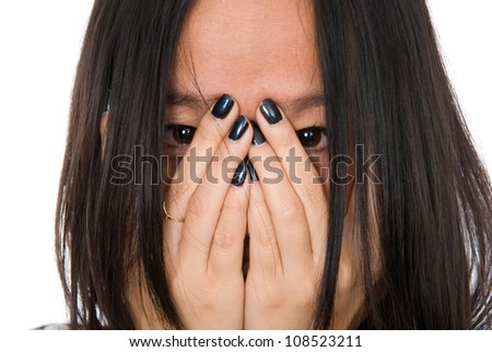 Close-up portrait girl in despair shuts face with hands.Isolated on white background - stock photo