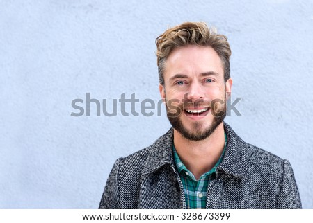 Close up portrait handsome smiling man with beard - stock photo