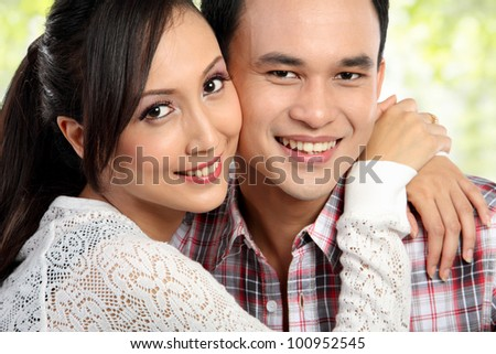 close up portrait Happy young couple embracing - stock photo