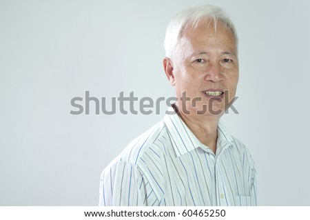 close up portrait if senior asian business man - stock photo