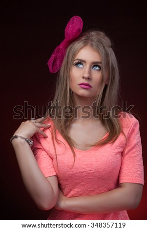 Close-up portrait, isolated, Blonde model with pink bow
