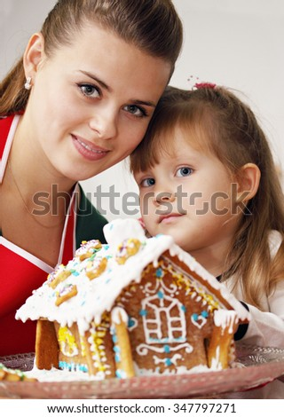 close-up portrait, mother and daughter with ginger house - stock photo