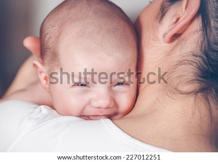 Close up portrait newborn baby in mother hands - stock photo