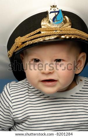 Close-up portrait of a baby captain - stock photo