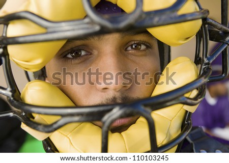 Close-up portrait of a baseball catcher wearing a mask - stock photo