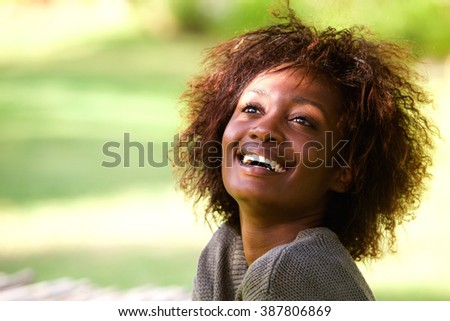 Close up portrait of a beautiful african american woman laughing - stock photo