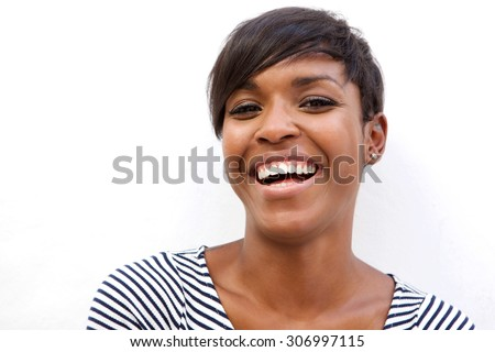 Close up portrait of a beautiful african american woman laughing on white background - stock photo