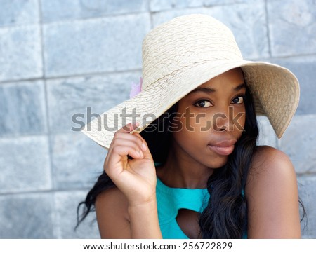 Close up portrait of a beautiful african american woman with sun hat - stock photo
