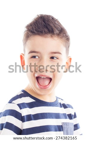 Close-up portrait of a beautiful and cheerful boy with his mouth open, looking to the side - stock photo