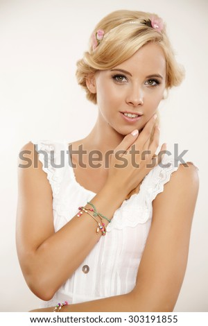 Close up portrait of a beautiful attractive sexy young adult sensuality pretty blonde woman in white elegance dress and flowers in blond hair isolated on white background - stock photo