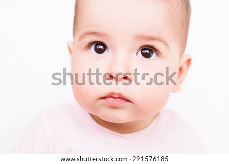 Close-up portrait of a beautiful baby on white background