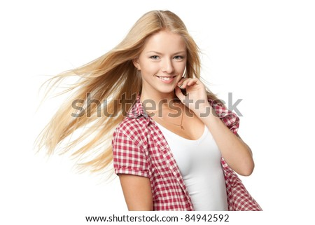 Close up portrait of a beautiful blond female with hair lightly fluttering in the wind over white background