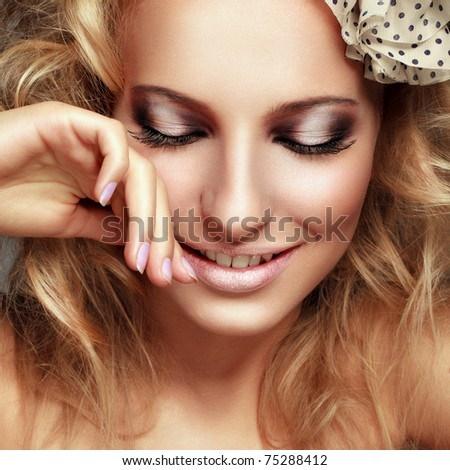 Close-up portrait of a beautiful blond girl - stock photo