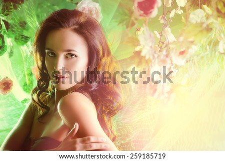 Close-up portrait of a beautiful brunette woman among tropical plants. Beauty, fashion. Spa, healthcare. Tropical vacation. - stock photo