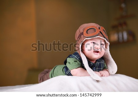 close-up portrait of a beautiful Chinese smiling baby - stock photo