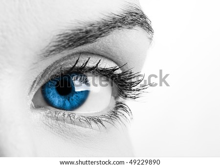 Close-up portrait of a beautiful female blue eye - stock photo