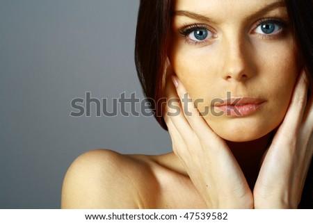 Close up portrait of a beautiful female model. - stock photo