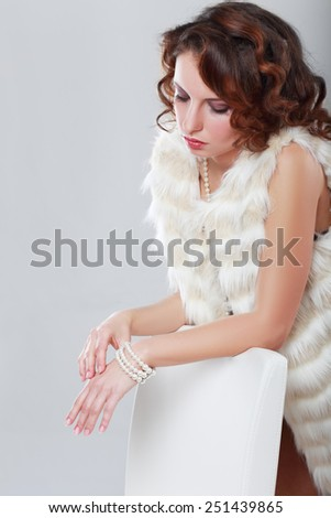 close-up portrait of a beautiful girl in a fur coat - stock photo