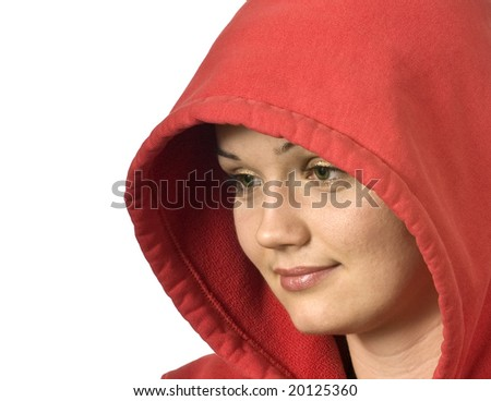 Close up portrait of a beautiful girl in a hood looking at blank space - stock photo