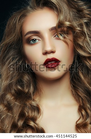 close-up portrait of a beautiful girl with blue eyes on a black background